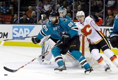 San Jose Sharks defenseman Brent Burns skates with and protects the puck (Feb. 9, 2015).