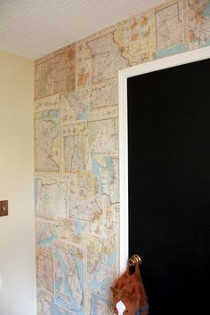 It all started with an atlas that I found at a yard sale for a dollar. I've had it for a while thinking that I would use it in some cr. Map Wall Decor, Wall Maps, Homemade Wallpaper, Map Collage, E Room, Map Wallpaper, Book Wall, Office Makeover, Floor Colors