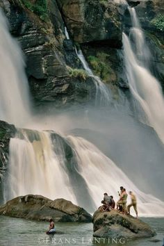 Men under waterfalls , Thrissur , Kerala.
