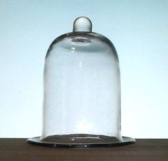 Hanging Candle Holder Flat Rim with Peg 4.25 x 5.25 Clear Glass   Heavy glass candle holder, shaped to fit into metal type ringed holders for candles. Hand blown, clear, with flat brim. Heavy glass with peg accent. Can also be used as a peg votive holder in a candlestick or sconce. Home Interiors or Partylite replacement.  Measures approximately 4.25 x 5.25 and can vary up to 1/8 inch in size.