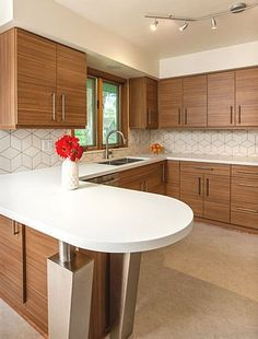 Mid-century modern kitchen design with a unique geometric tile backsplash. Such a light and bright kitchen!