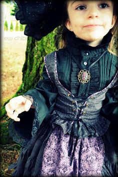 Gorgeous little witch costume. This mom's work puts mine to shame.