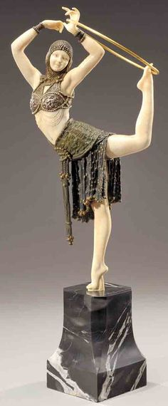 "Chiparus created one of the most iconic bronzes in 1928 called ""Danseuse au cerceau"" or ""Ring Dancer"" inspired in the famous and prodigious dancer Zoula de Boncza of the Parisian ""Folies Bergere"", a first dancer of The Belgrado Royal Opera and a Mime dancer of ""l'Opéra-Comique"" in Paris."