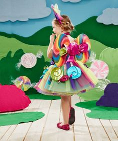 This girls candy fairy costume is covered in treats, including bright candies dangling around her fluffy tulle skirt. A Wishcraft costume by Chasing Fireflies.