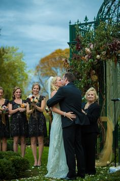 First kiss as Mr. & Mrs. with gorgeous Oleander flowers at The Inn at Barley Sheaf Farm | Juliana Laury Photography