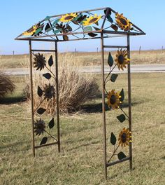 This is a very colorful arbor with sunflowers attached to it. Made of iron with cut out sunflowers your vines will love growing up the sides of this Wrought Iron Trellis, Meadow Garden, Plant Supports, Vines, Outdoor Structures, Sunflowers, Gardening, Animals, Animales