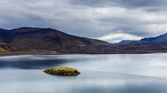 Lake with small island in Iceland by grycikua on @creativemarket