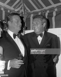 American actors John Wayne and Steve McQueen share a laugh during the Annual Golden Globe Awards ceremony at the Cocoanut Grove, Los Angeles, California, February Get premium, high resolution news photos at Getty Images John Wayne, Steeve Mac Queen, Steve Mcqueen Style, The Quiet Man, Lee Marvin, Faye Dunaway, Angie Dickinson, Westerns, Old Movie Stars