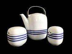 Up for sale I am offering a vintage set produced by Rosenthal Studio Linie of Germany and designed by Finnish design master Timo Sarpaneva. It is part of the SUOMI range and decorated in the rare Concept 3 ( blue stripes over white background). The set consists of 8 cups and their