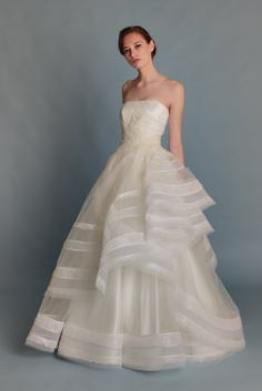 Off white bustier bridal gown in layers tulle with by Shadifashion