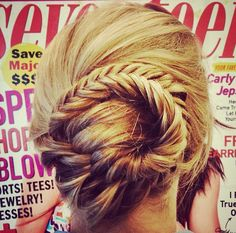 Get creative with your hair on game day with a twisted fishtail braid