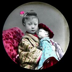 Late 1870s to 1880s studio image of a young Japanese girl and her doll. Photographer unknown.  Collodion Emulsion (Wet Plate) Photo on Glass from OLD JAPAN (1) by Okinawa Soba, via Flickr