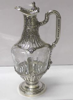 Victorian Silver and Crystal Claret Jug  . Height 30 cms. London 1898. Maker James Wakely & Frank Clarke Wheeler. - http://www.waxantiques.com/items/6511%20Victorian%20Silver%20and%20Crystal%20Claret%20Jug/6511.htm