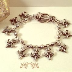 """King Baby Studio Fleur De Lis Charm Bracelet 8.5 King Baby Studio Fleur De Lis Charm Bracelet Sz 8.5. Sterling silver. In perfect condition. 9"""" from end to end. Fits 8-8.5"""" wrist best. Heavy! All handmade, can be sized up or down. King baby studio Jewelry Bracelets"""
