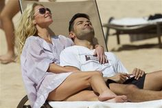 Kelly Ripa and her husband, Mark Consuelos, catch some rays in heaven... uh... Hawaii on Feb. 17, 2012