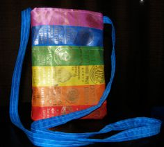 Rainbow purse from dog show ribbons. Horse, dog, 4H, track, swimming, pageants. Sholder strap, zipper purse. LGBT pride month. Ribbon display. Rosettes and awards. Ribbon quilting. Agility obedience training conformation. Repurposed vintage. Upcycle. Handmade.