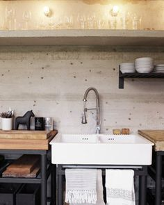 Natural, industrial kitchen with wood counters - large sink and hand towels are rockin'