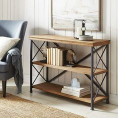 Solid mango wood sits in a handcrafted iron frame to make our Metro shelf a flawless addition your modern decor. With a versatile low design, it's perfect for an office or study, but it easily adapts to provide unique storage solutions in any space.