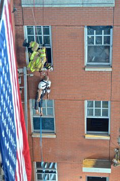 FDNY Rescue Paramedic Juan Henriquez treats a simulated victim during a high-angle rescue.