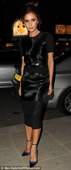 Victoria Beckham wore a black shift skirt and a matching short sleeved jumper from Victoria's Autumn/ Winter 2013 collection