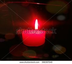 Red candle in the night