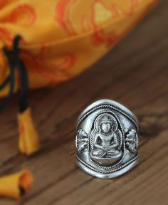 Adjustabel sterling silver ring depicts Buddha meditating in a position of absolute stillness and inner balance. Handmade in Nepal.