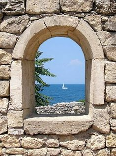 the frame is the stone wall and the main object is the boat Window View, Open Window, Beautiful Places, Beautiful Pictures, Door Murals, Through The Window, Stairways, Windows And Doors, Porches