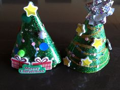 Toddler craft! Today we used party hats to make Christmas trees! Decorated with whatever we could find