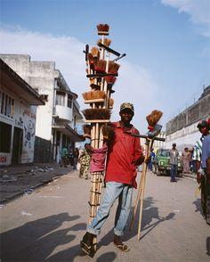 Street vendors of brooms. Kinshasa.