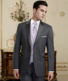 Grey Tuxedo with lilac tie, vest and pocket square.  Contact us for more information on tuxedo rentals at Euphoria Bridal Boutique.