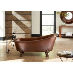 This freestanding claw foot tub will serve as a stunning bathroom centerpiece. The tub is built to last with 14-gauge solid copper construction. It's roomy enough for two!