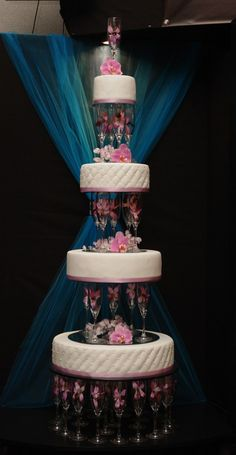 Pink Wedding Cakes champagne glasses cake separators filled with flowers. Very similar to my wedding cake 18 years ago Champagne Wedding Cakes, Round Wedding Cakes, Wedding Cake Stands, Elegant Wedding Cakes, Beautiful Wedding Cakes, Gorgeous Cakes, Wedding Cake Designs, Pretty Cakes, Amazing Cakes