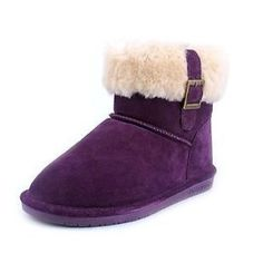 BEARPAW® Women's Abby Winter Boot Spice up your boot collection with BEARPAW®. Perfect for lounging, running errands or hanging out with friends, the Abby features a suede upper and sheepskin collar detail with a side buckle and tab decoration show off your cool, confident style. Genuine sheepskin interior and footbed delivers soft comfort, while the rubber wedge outsole delivers the traction you need to stay comfortable in the winter weather. Sizing tip:Order 1 full size up for the most…