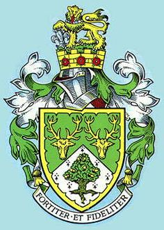 FULWOOD URBAN DISTRICT COUNCIL   ARMS: Per chevron Vert and Ermine in chief two Stags' Heads caboshed Or in base an Oak Tree eradicated proper fructed Gold all within a Bordure engrailed of the last. CREST: Out of a Mural Crown Or charged with three Roses Gules barbed and seeded proper a Mount Vert thereon a Lion passant guardant also proper gorged with a Torse Argent and Azure and resting the dexter forepaw on a Fleur de Lys also Argent.