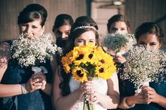 Sunflower and baby's #breath bouquets! Gavin Crews Photography l Read more http://www.rusticfolkweddings.com/2014/08/08/rustic-mexican-ranch-wedding/