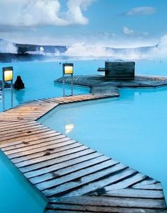Blue Lagoon, Iceland - it's the sulphur that makes the water so blue. The locals rub the volcanic rock and sulphur from the bottom of the lagoon on their bodies and use it as a face mask.