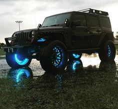 BLACKED OUT WITH BLUE LIGHTS JEEP JK