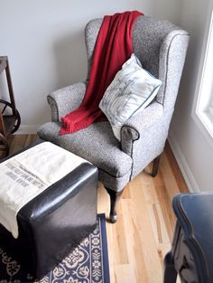 Grey chair with red blanky