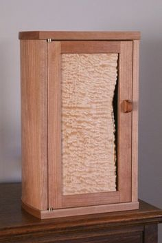 Quilted maple and cherry jewelry cabinet
