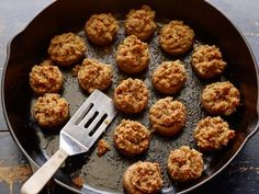 An easy side dish or appetizer for Thanksgiving dinner -- Food Network's stuffed mushrooms in a cast iron skillet.