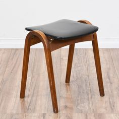 """I want to replicate this """"Isamu Kenmochi for Akita Mokko"""" stacking stool. It's featured in a molded wood with a glossy cherry finish. This 1960's mid century modern stool is in great condition with a curved slanted base, a sleek modern design and a shiny black vinyl seat. Stylish Japanese stool perfect for a desk or dining table!"""