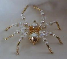 a bunch of these little beaded spiders and never once thought of using pearls. Shame on me, it looks freakin awesome!:made a bunch of these little beaded spiders and never once thought of using pearls. Shame on me, it looks freakin awesome! Wire Jewelry, Jewelry Crafts, Beaded Jewelry, Jewelery, Handmade Jewelry, Pearl Jewelry, Beaded Crafts, Beaded Ornaments, Diy Ornaments