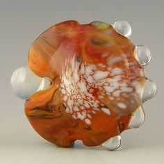 handmade lampwork glass bead a large lentil focal eating a small marble (no really!) - Alternate Reality