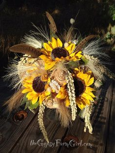 "First off this will be part of my bouquet... It will have RED sunflowers. The pheasant feathers . My grandpa's wedding ring hanging off of it. I like the idea that Kris had of wrapping it in burlap & lace. And it'd be combined with that other bouquet picture I have. I hope she can add more ""woodsy"" type stuff to it. This looks more like a wheat farmers bouquet."