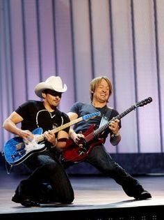 Brad Paisley, left, and Keith Urban open the show with