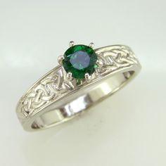 A 14K White Gold Celtic engagement ring set with a Tsavorite Garnet.