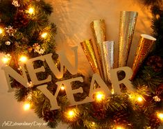 "DIY ""New Year's Wreath"" decorated with Gold Letters & Paper Horns 