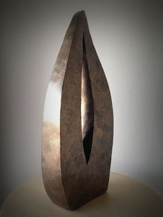 An abstract sculpture in clay with patina by Anne Beaurin of the Hangar Artists - Abstract Vibrations IV