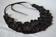 Black leather statement necklace by Cristina Costache