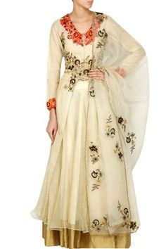 Featuring a cream front open asymmetrical hemline jacket in silk tissue with shades of orange and gold floral thread work on the bodice. It is paired with a matching layered silk organza lehenga. It comes along with a cream embroidered floral bootis organza dupatta   by NEERA BHARGAVA.Shop now at www.carmaonlineshop.com#carma #carmaonlineshop #style#fashion #designer #indianfashion #dreamingfashion #ootd #ootn #pretty #ethereal #elegant #indianwear #pretaporter #shopnow #wednesdaywants…